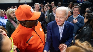 Joe Biden shakes hands with supporters during a campaign event at Wofford University