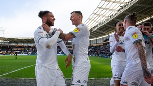 Leeds' Tyler Roberts celebrates scoring his side's fourth goal with Ben White