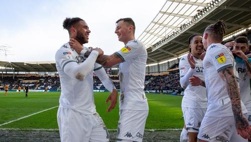 Leeds' Tyler Roberts celebrates scoring his side's fourth goal with Ben White