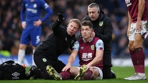 James Tarkowski of Burnley is assessed for concussion during a match between against Chelsea at Stamford Bridge in January.