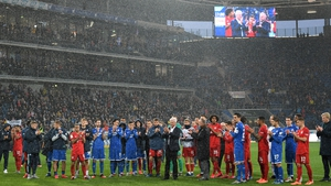Karl-Heinz Rummenigge and Dietmar Hopp come together with players to applaud the home fans