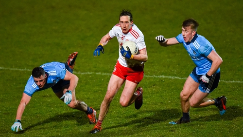 Colm Cavanagh of Tyrone in action against Dublin's Brian Howard (L) and Seán Bugler.