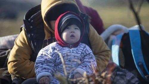 Women and children were among the 2,000 people arriving at the Pazarkule border gate