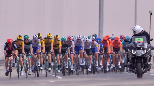 Cyclists ride during stage four of the UAE cycling tour in Dubai, on 26 February 2020