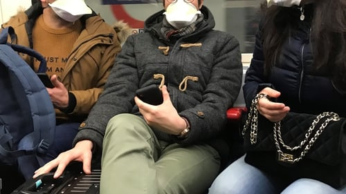 People on London's Tube wear face masks