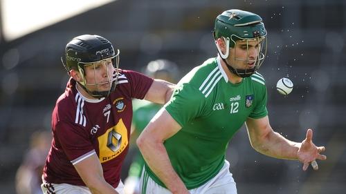 Limerick's Brian Ryan gets past Liam Varley