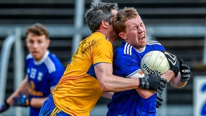 Chris Conroy of Cavan battles with Clare's Jack Browne