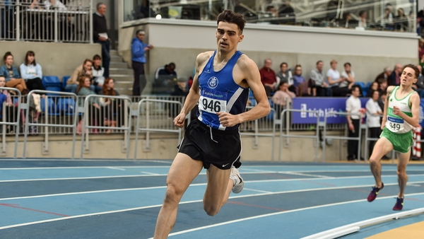 ndrew Coscoran (l) on his way to winning the Senior Men's 1500m event