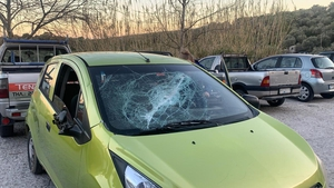 One of the five rental cars that were attacked by groups with planks of wood