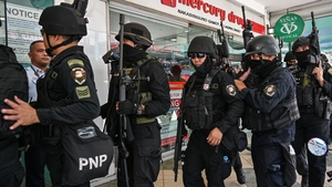 An armed police team entering the shopping complex earlier