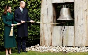 Facing the music: The couple ring the 'peace bell' at Áras an Uachtaráin