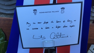 """Striking a note: The message on the royal wreath laid at the Garden of Remembrance says: """"May we never forget the lessons of history as we continue to build a brighter future together"""""""