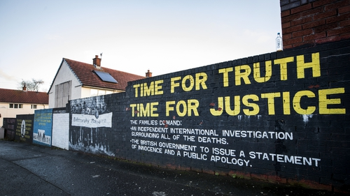 Mural on a wall in the Ballymurphy area of west Belfast where the shooting of 10 civilians took place in 1971