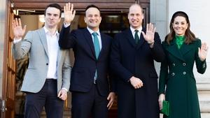Show of hands: Taoiseach Leo Varadkar and his partner Matt Barrett greet the royal couple at Government Buildings