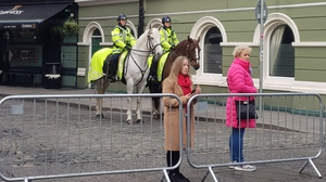 Mounted gardaí and members of the public at the barriers of road closures in Dublin city centre (Pic: RollingNews.ie)