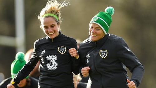 Julie-Ann Russell (L) and manager Vera Pauw bump shoulders in training