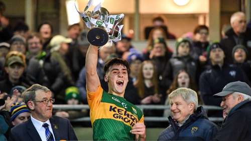 Kerry captain Paul O'Shea lifts the cup