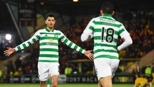 Celtic's Nir Bitton celebrates with Tom Rogic