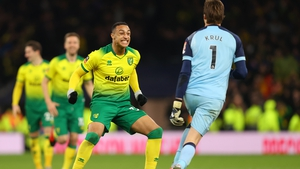 Adam Idah (L) celebrates with Norwich goalkeeper Tim Krul
