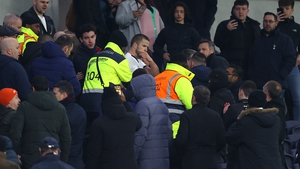 Eric Dier is ushered away by security at Tottenham Hotspur Stadium