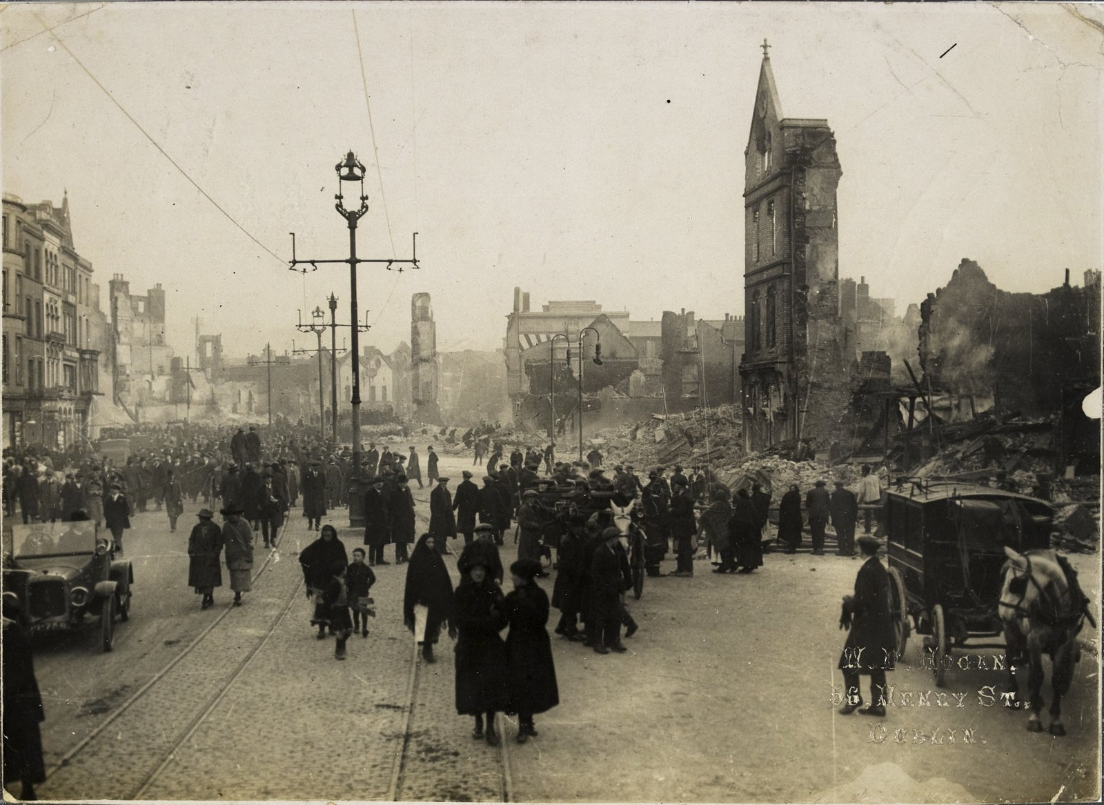 Image - Crowds gather amid the ruins, 13th of December, 1920. Image courtesy of the National Library of Ireland