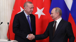Russian President Vladimir Putin and Turkish counterpart Recep Tayyip Erdogan shake hands at a press conference