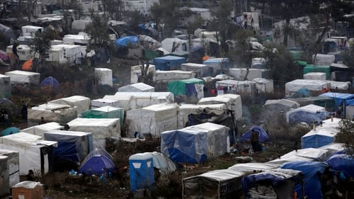 Thousands of people are living in makeshift accommodation at camps on either side of the frontier
