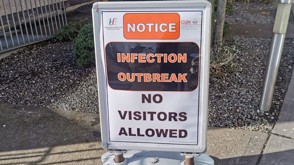 A sign outside Cork University Hospital warning visitors about the virus
