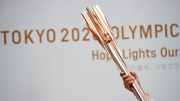 The torch relay has been forced off public roads in some areas over fears it will spread the virus