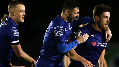 Sam Bone (R) is congratulated after drawing Waterford level