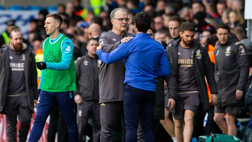 Leeds United manager Marcelo Bielsa comforts Huddersfield Town manager Danny Cowley after the match