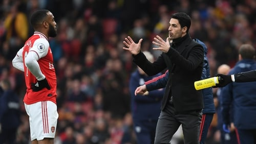 Arsenal Head Coach Mikel Arteta talks to Alex Lacazette during the match