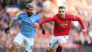 Luke Shaw (r) and Sergio Aguero battle for possession