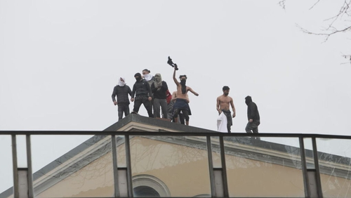 Inmates on a rooftop at the San Vittore prison in Milan
