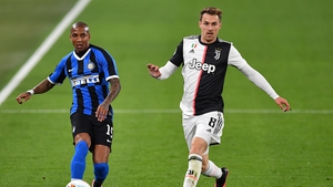 Aaron James Ramsey (R) competes with Ashley Young during Juventus' win over Inter