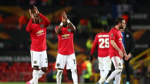 Fred and Odion Ighalo of Manchester United applaud the fans during the UEFA Europa League round of 32 second leg match against Club Brugge