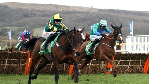 Lisnagar Oscar ridden by jockey Adam Wedge (left) on his way to winning the Paddy Power Stayers' Hurdle
