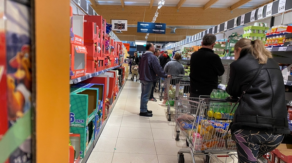 Shoppers queue in Lidl in Swords, Dublin