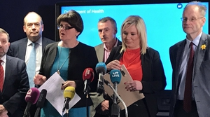 Arlene Foster made no attempt to hide her disapproval as Michelle O'Neill said schools should be closed