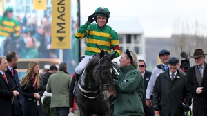 Jockey Barry Geraghty celebrates on Saint Roi after winning the Randox Health County Handicap Hurdle