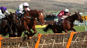 Monkfish ridden by Paul Towned (centre) jumps the last on the way to winning the Albert Bartlett Novices' Hurdle