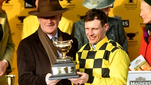 Paul Townend (R) celebrates with Willie Mullins after winning the Gold Cup