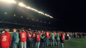 Stewards clear the pitch after rioting in Lansdowne Road's Upper West Stand caused the 1995 friendly to be abandoned