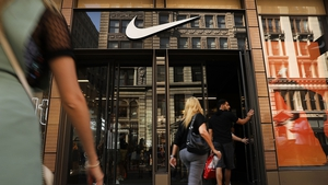 Nike said its quarterly revenue rose to $10.36 billion from $10.1 billion