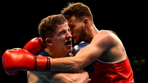 Michael Nevin (L) defeated Max Van Der Pas of the Netherlands in their middleweight 75KG Preliminary round bout