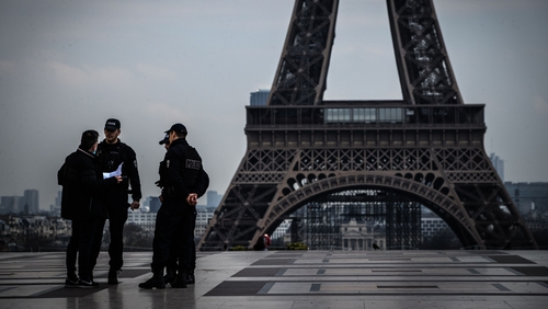 Police control people at the Eiffel Tower in Paris