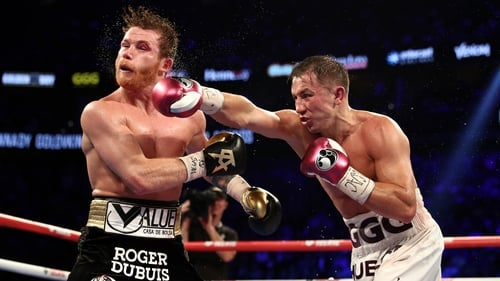 Gennady Golovkin punches Canelo Alvarez during their WBC/WBA middleweight title fight in 2018