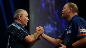 Phil Taylor (L) and Raymond van Barneveld look set for another clash