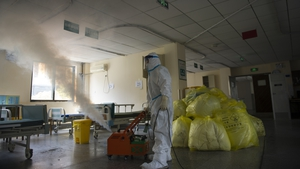 A worker disinfects around the No. 7 Hospital, once designated for only COVID-19 patients, in Wuhan in central China's Hubei province