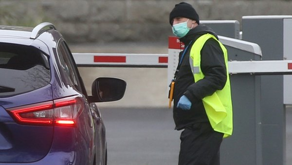 A security guard at St Michael's Hospital, Dun Laoghaire where Covid-19 testing is taking place. Photograph: Sam Boal / RollingNews.ie